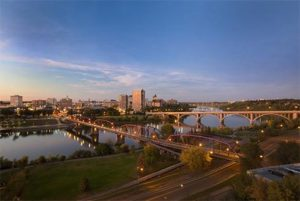 YXE-Saskatoon_Downtown-and-South-Saskatchewan-River_Credit-Tourism-Saskatoon_490x329