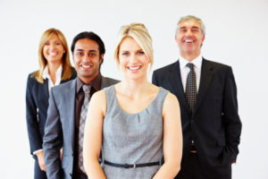 Multiracial business team standing in line laughing